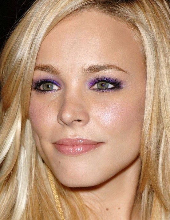 Only she could pull of bright purple eyeshadow and still make it look subtle.  Love her.