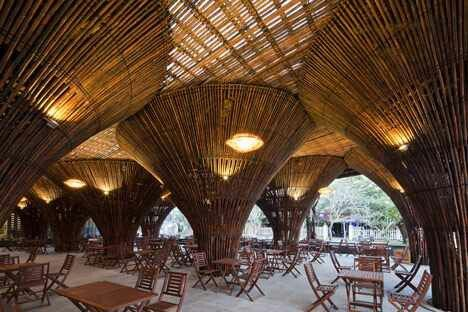 Fifteen conical bamboo columns support the roof of this waterside cafe designed by Vo Trong Nghia Architects at a hotel in central Vietnam.: