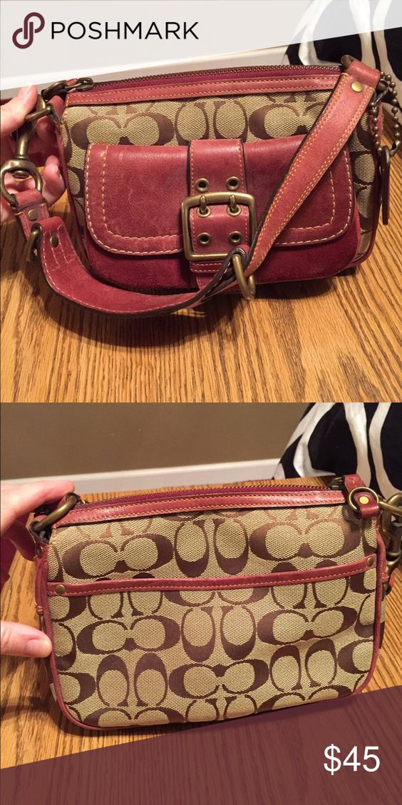 Burgundy and Tan Coach purse Burgundy and tan Coach purse. First Coach purse I ever purchased!!  Probably early 2000s. Good condition- gently used. Bags Shoulder Bags