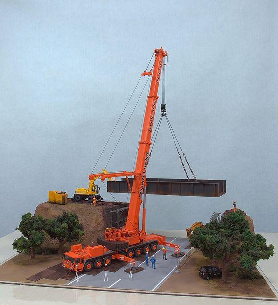 Diorama retratando instalação de ponte ferroviária.
