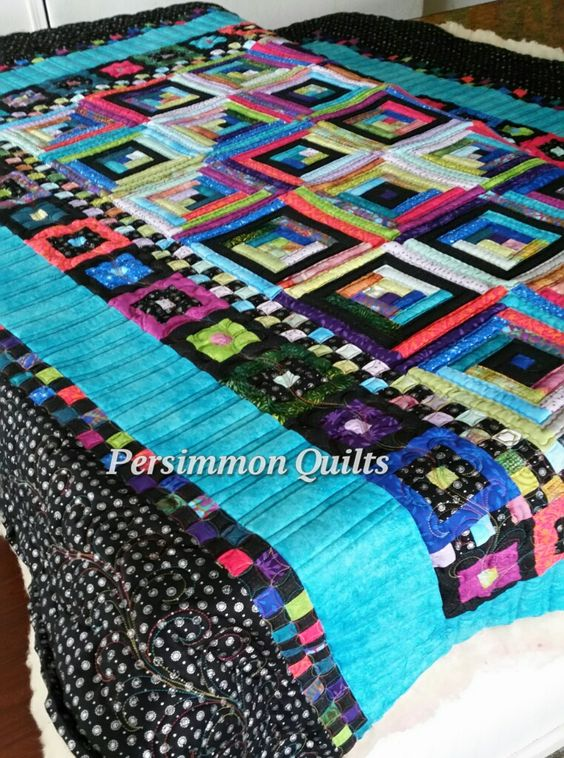 Log Cabin quilt made by Audrey.  Longarmed by Le Ann Weaver of Persimmon quilts.