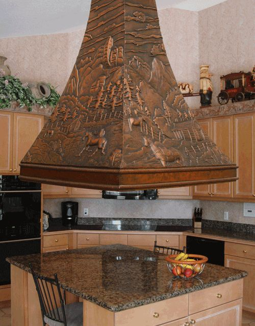 copper kitchen island hood and hammered copper sink  Copper