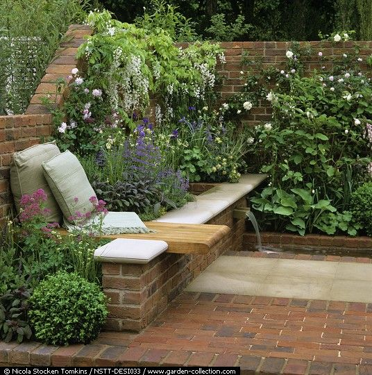 9 Front Garden Ideas Anybody Can Try: City Retreat Enclosed By Walls. Stone / Brick Floor. Bench