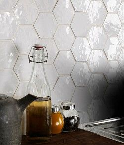 Bisquette hexagonal tile in white by Topps Tiles add a whole new level of texture and pattern to a plain white splashback in the kitchen. http://www.toppstiles.co.uk/search_results.asp?section=1157&page=1&model=kitchen-tiles&rangeid=650&view=products&n=1