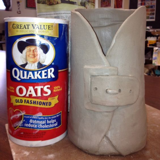 Slab vase with newspaper wrapped Quaker Oats can.