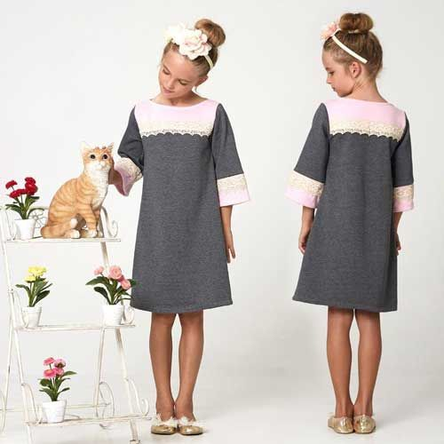 This stylish girl's dress is comfortable to wear and features a simple boat neck and contrast yoke.