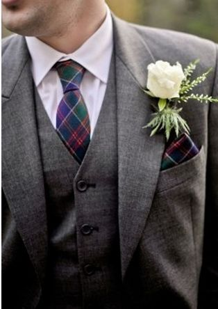 Incorporating plaid into a wedding can be done most seamlessly through the men's attire.