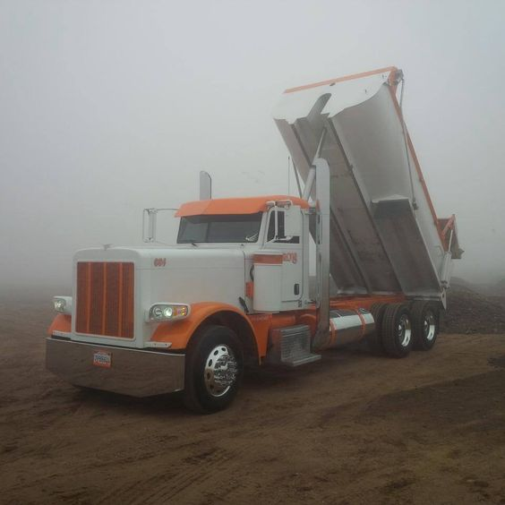 Orange and white Peterbilt transfer dump