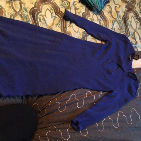 Bebe Sweater Dress Beautiful low cut sweater dress. Form fitting with cleavage showing. Great dress for a dinner date! bebe Dresses Midi