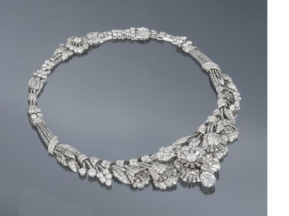 Diamond tiara/necklace/bracelet c. 1935 | Tiara designed as a highly articulated garland with meandering baguette-cut diamond stems issuing brilliant, baguette and single-cut diamond leaves and buds and a series of trumpet-shaped flowers, culminating at the centre with a full bloom mounted en tremblant, surmounted by a pear-shaped diamond weighing 2.21 carats; remaining diamonds approximately 36.60 carats total. | Manoah Rhodes & Sons Ltd, Diamond Merchants, Bradford | Sold for £97,250
