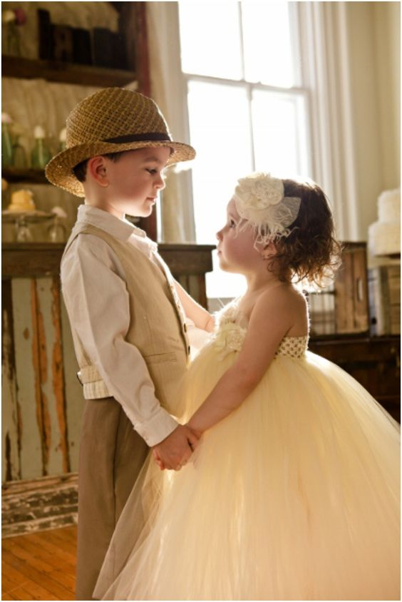 adorable little bride and groom holding hands