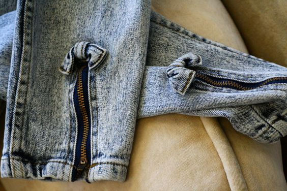 jeans with zippers and a bow at the ankle