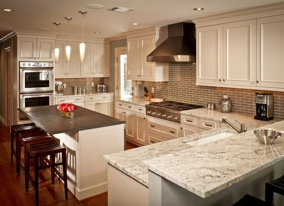 This kitchen has some unique aspects going on with the granite because the island is entirely different from the rest. That gray though really seems to emphasize the gray colors in the rest of the Bianco Romano granite.