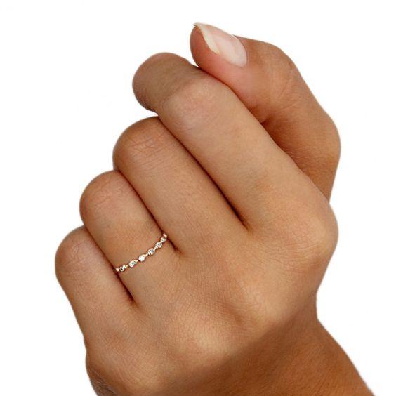 Diamond drop 14 carat rose gold eternity ring by Astley Clarke Muse.