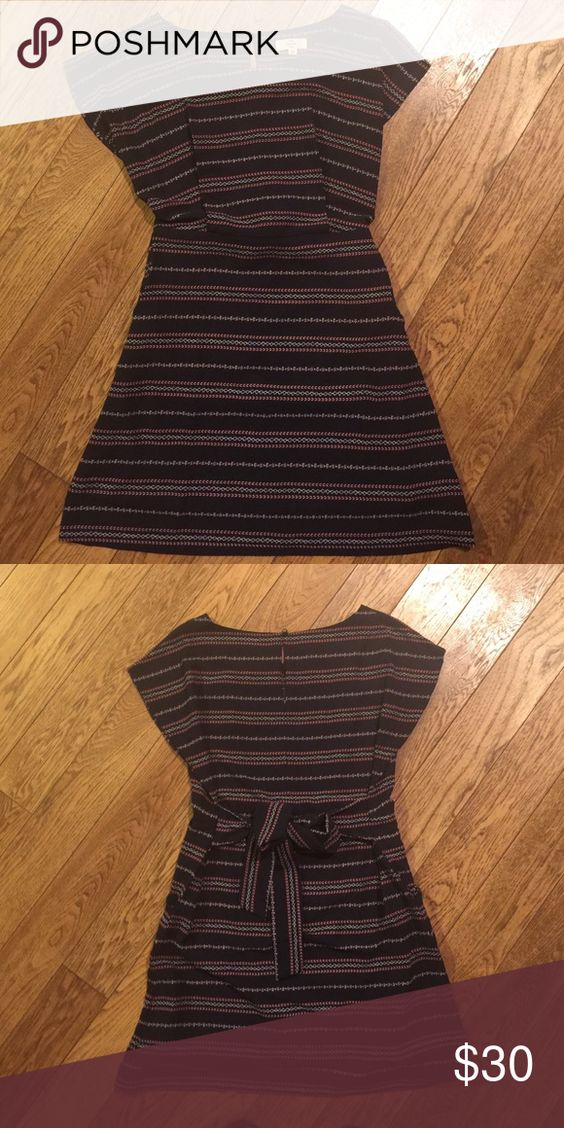 Navy detailed lightweight dress Excellent condition.  Brand new, never worn.  Dark navy in color.  The dress has pockets with back tie feature. entro Dresses Mini
