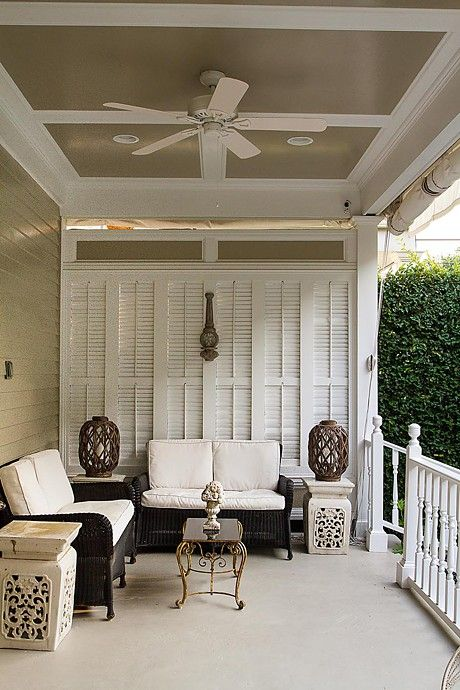 The owners used the house's original cypress shutters as architectural accents for their Metairie, Louisiana porch.: