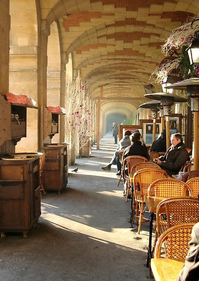 Arcades of the Place des Vosges in the Marais, Paris