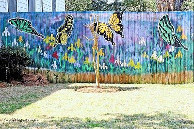 Gorgeous butterfly mural on the fence i want to do this for Butterfly garden mural