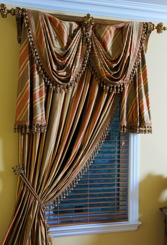 Single Drapery Panel Tied Back With Long Scarf Over Wooden Pole Creating 2 Swags Side Jabots