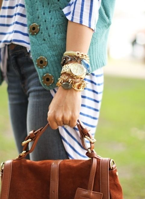 the teal sweater vest, the stripes the arm candy and satchel!!