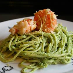 Butter, cream, Parmesan cheese and pesto converge into a luxurious sauce to be served with cooked shrimp or crab meat and hot linguine.