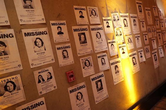 Missing-person posters were plastered throughout the event space - missing person posters