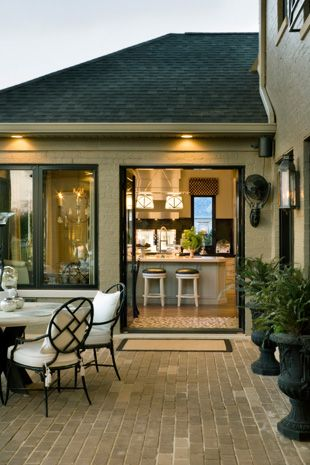 Love the patio just a step out of the kitchen - Joy Tribout Interior Design