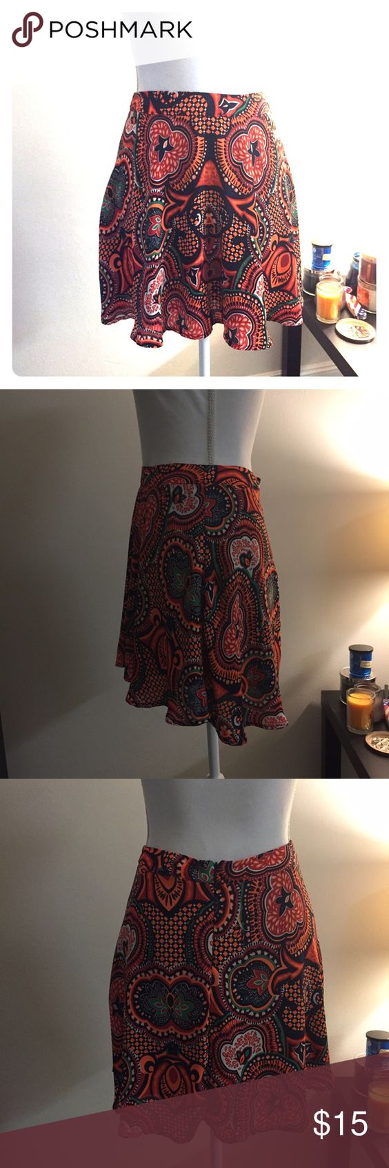 """Colorful patterned skater skirt Cute multicolored patterned skater skirt. Size XS but can fit a small. Waist is 28"""" length is 18"""" Forever 21 Skirts Mini"""