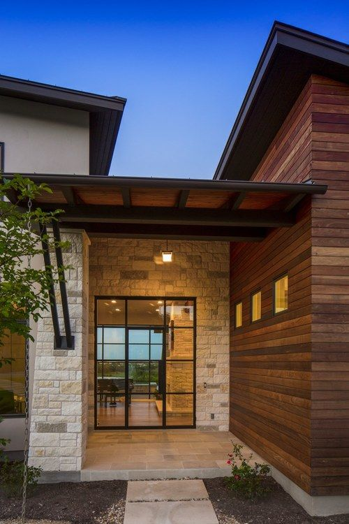 Contemporary home hacienda ridge entryway stone wood for Homes with wood siding
