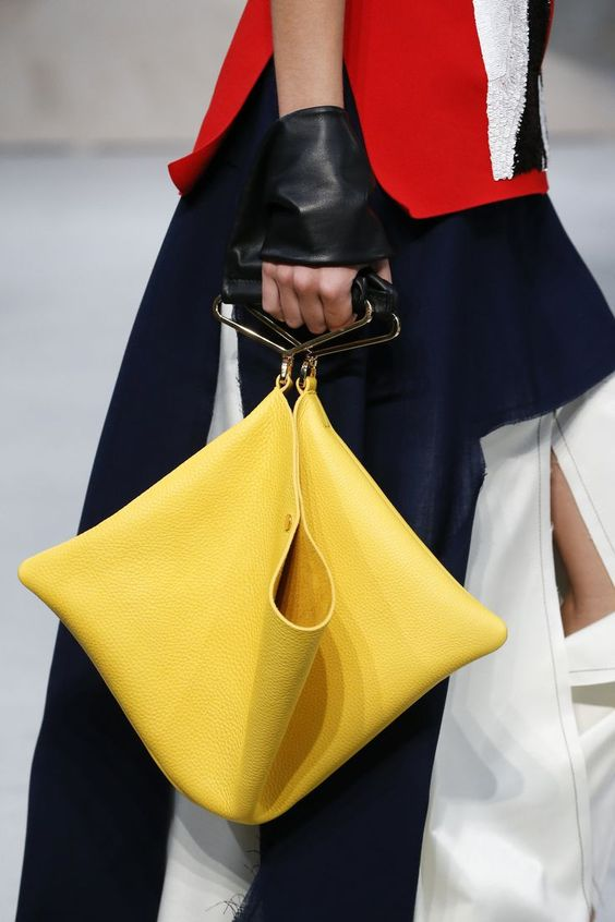 This purse is so modern mod! Edgy chrome handles, origami fold up and banana yellow leather! Want!  Marni Spring 2016 Ready-to-Wear Accessories Photos - Vogue