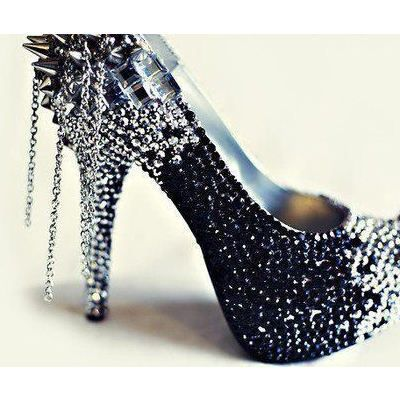 The design element of jewels hanging off the rear of the shoe is dazleing!!