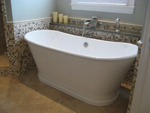 This deep free standing soaker tub fills in style with our for Deep soaking tub alcove