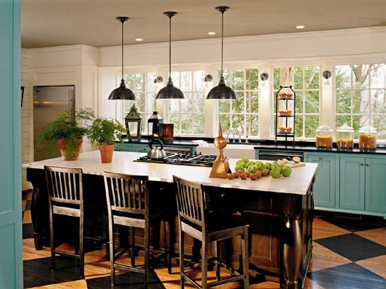 not a fan of the floors, but a kitchen with this many windows is my dream!