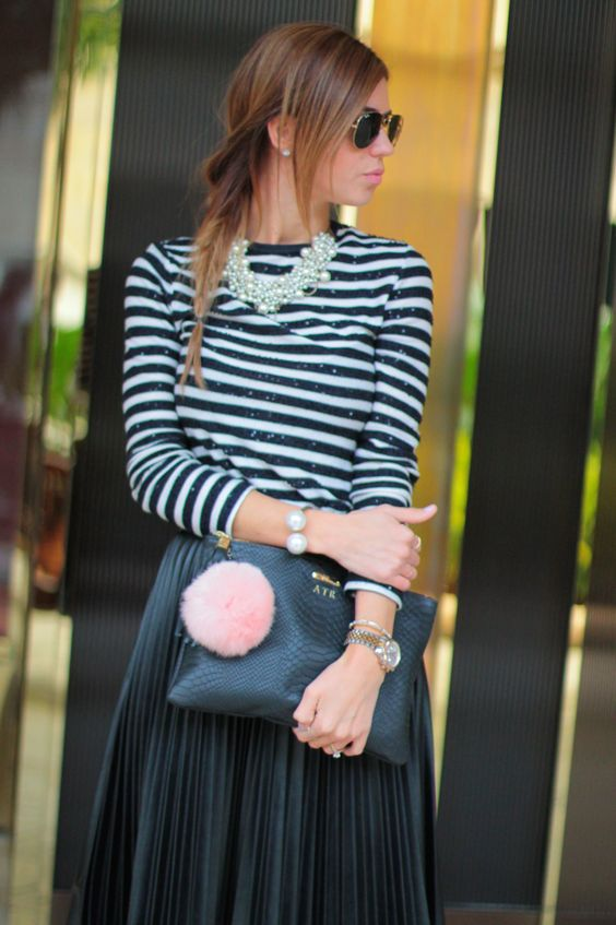 Black faux leather pleated skirt, striped top, fur key chain, ray ban sunglasses, pearl bracelet and strappy heels. {delicately pleated}