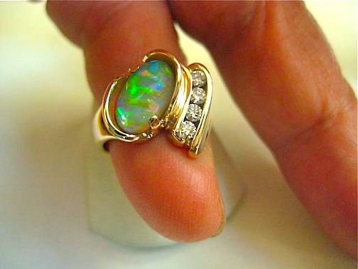 Top of the line Lightning Ridge Crystal opal and diamond ring.  One of a kind ring by Glenn Dizon Designs.  Stunning and available