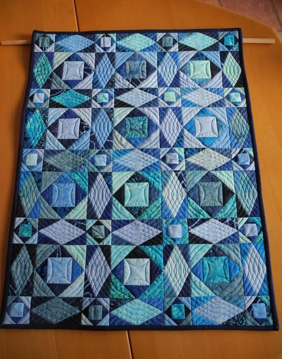Wow. I think this is a tough block to make at full size!  And the quilting enhances it.  Not sure who made this Miniquilt