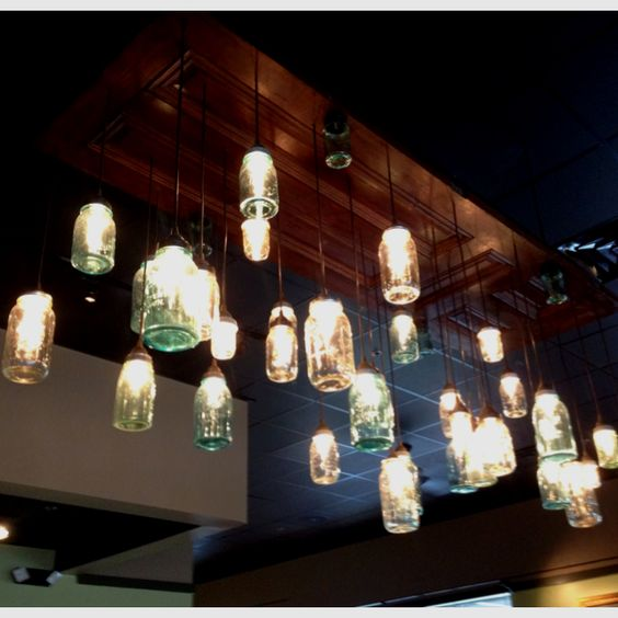 Hanging mason jar lights from an antique door, light fixture at Heirloom Eats