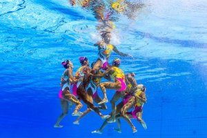 Team Japan, competing in the synchronised swimming team free routine final