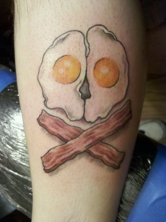 Egg skull & bacon crossbones. Done at a tattoo party in New Jersey.