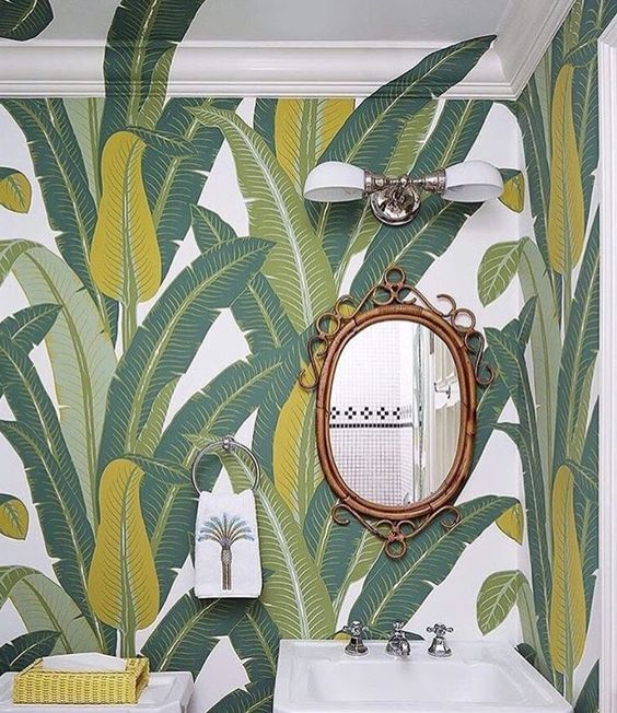 The dream powder room or bathroom wall paper. Love how the designer has extended details over the crown moulding.