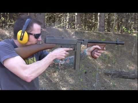 Thompson Sub Machine Guns - video includes cocking.the gun