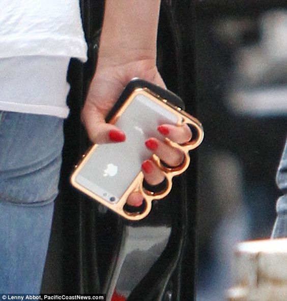 Is the catfight getting cattier? The actress carried a knuckleduster iPhone cover, an item that has recently been the subject of legal controversy