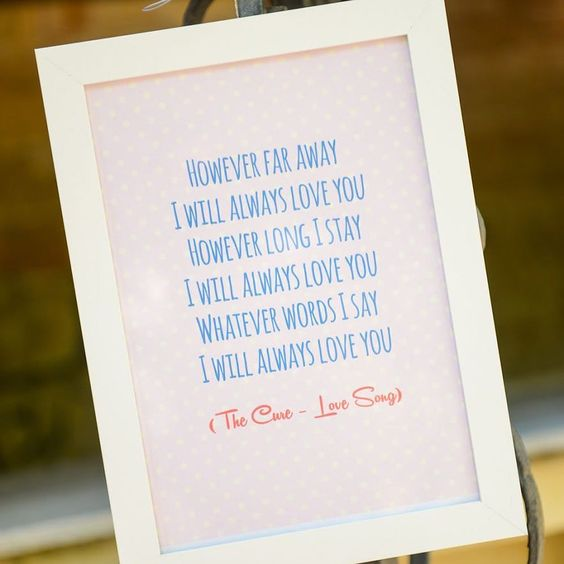 Loving this Cure lyrics table piece at @carmelaweddings wedding!! Full blog - http://bit.ly/2chiFG7  @krismicallefphotographer