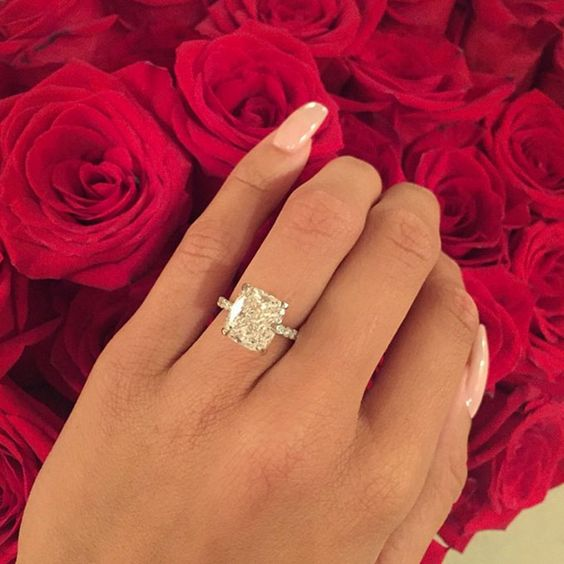 """Brides.com: . Draya Michelle's Engagement Ring. Basketball Wives LA star Draya Michelle said """"yes"""" to Dallas Cowboys cornerback Orlando Scandrick's proposal at the site of their first date, Arclight Cinemas in Sherman Oaks — and to this killer radiant-cut solitaire with a pavé band."""