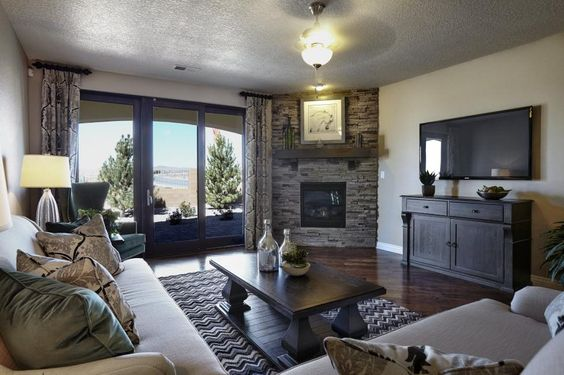 A cozy living room with a prime view of the New Mexico countryside. #DRHorton #Homes