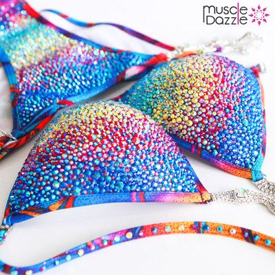 This stunning crystal competition bikini comprises a beautiful mix of 4 different crystal colors - Aqua Marine , Citrine , Siam and Sapphire on Blue / pink / orange tied dye fabric.