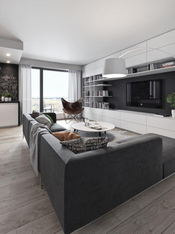 Salón de estilo moderno con muebles blancos y pavimento de madera.