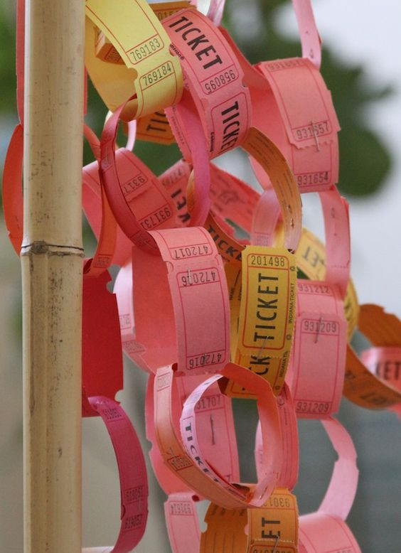 paper chains are fun...tickets are used here to decorate pam garrison's booth @ renegade fair