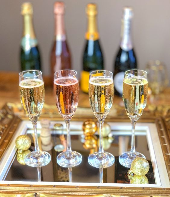 How to Host a Sparkling Wine Tasting for New Year's Eve. We've got all the instructions for hosting an awesome sparkling wine tasting, including food pairings in the form of delicious canapés. It's an easy way to host a party at home for New Years Eve, not to mention a ton of fun. #sommelier #champagne #rosé #winepairings #wintetasting #newyearsevepartyideas #newyearseve #newyearseveparty #newyears #wine #winetastingevents #winetastingnotes