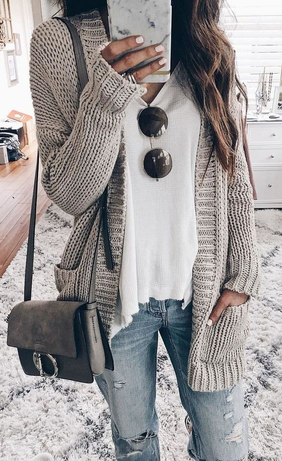 Grey chunky knit cardigan sweater, white tshirt, distressed boyfriend jeans, suede crossbody bag. Spring, fall, winter outfit street style inspiration ideas.